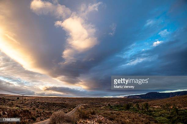 Puffy clouds over desert landscape, Clanwilliam, Western Cape Province, South Africa
