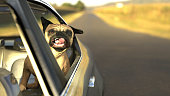 Pug dog in backseat car window with twisted tongue 3d illustration