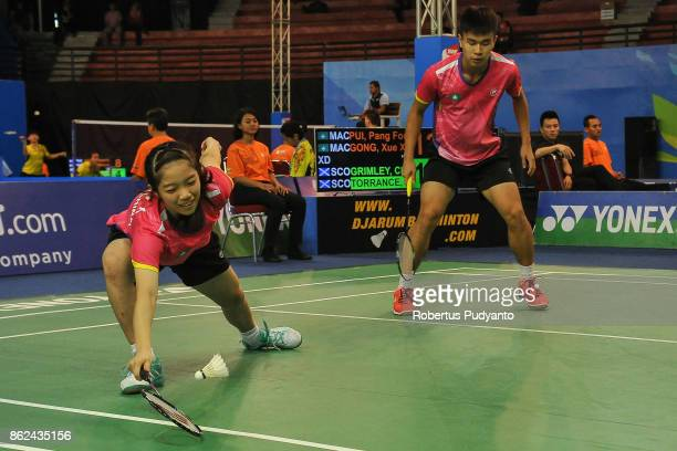 Pui Pang Fong and Xue Xin Gong of Macau compete against Christopher Grimley and Ciara Torrance of Scotland during Mixed Double qualification round of...