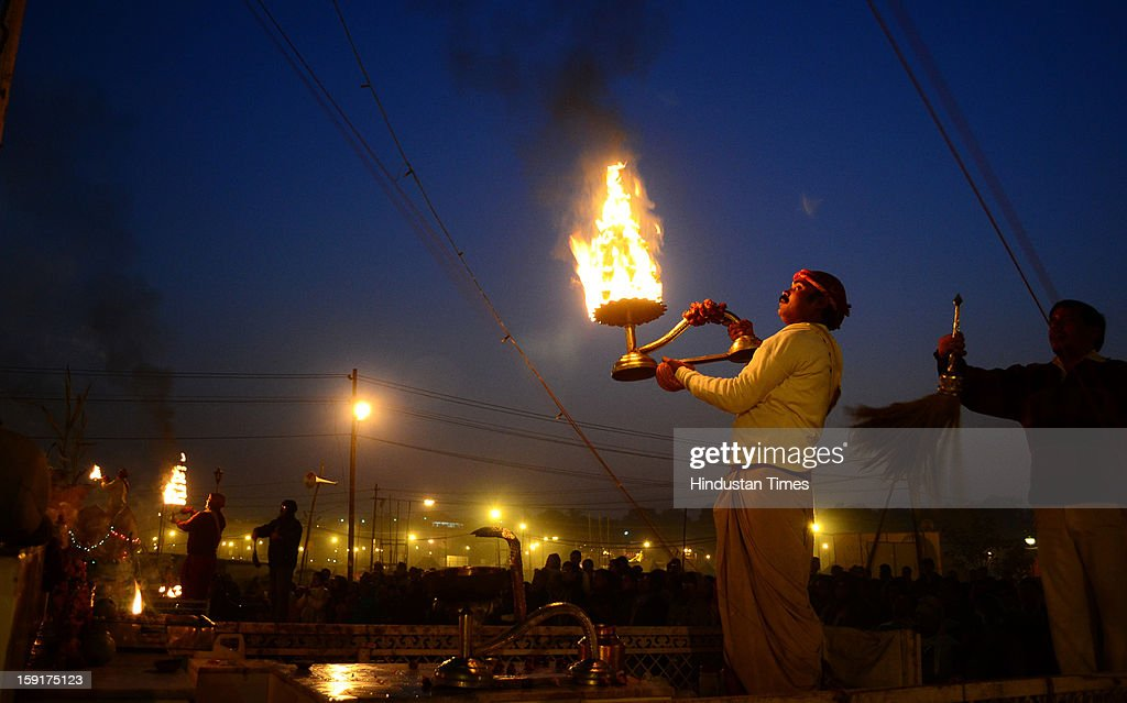 A Pujari performs 'Aarti', a ritual in River Ganges at Sangam on the confluence of rivers Ganga, Yamuna and mythical Saraswati on January 9, 2013 in Allahabad, India. The Kumbh Mela is mass Hindu pilgrimage that alternates between four places Allahabad, Haridwar, Ujjain and Nashik every three years. The current Kumbh is scheduled to take place at Allahabad city in January and February 2013 and is expected to be attended by 60 million devotees
