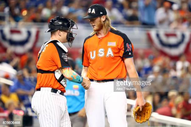 J Puk and Zack Collins of Team USA celebrate after defeating the World Team in the SirusXM AllStar Futures Game at Marlins Park on Sunday July 9 2017...