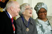 Pulitzer Prize winner and author of 'To Kill A Mockingbird' Harper Lee smiles with CSPAN President and CEO Brian Lamb and Liberia president Ellen...
