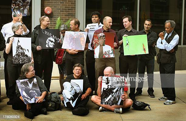 Pulitzer prize winning former Chicago SunTimes photographer John H White gestures as current and former Chicago SunTimes newspaper employees and...