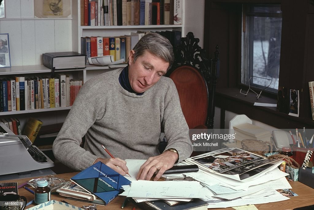 Pulitzer Prizewinning novelist John Updike photographed working at his home in Beverly Farms Massachusetts in 1978