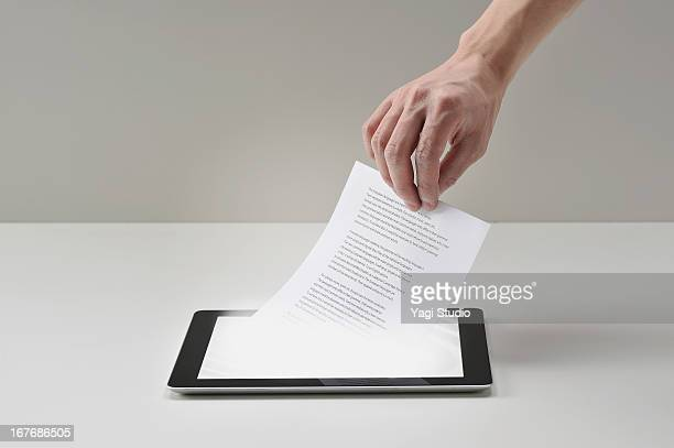pull documents out of digital tablet