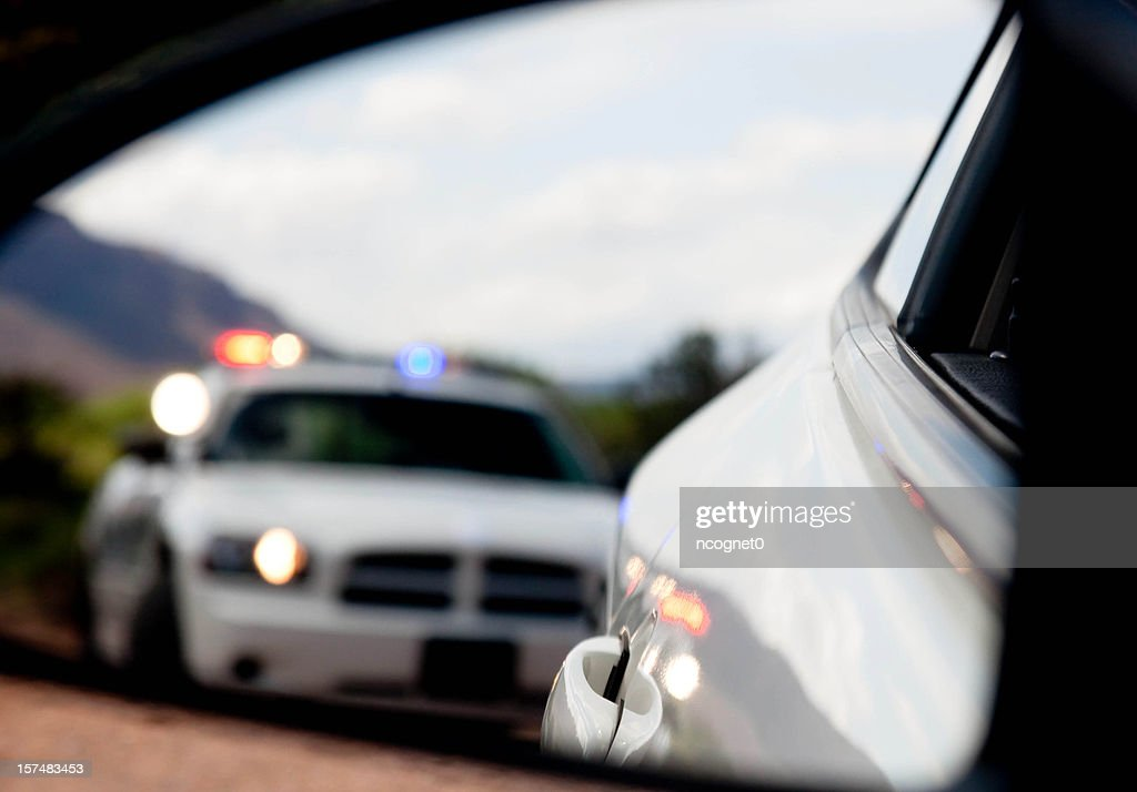 Pulled over by the Police in blurred Dodge Charger : Stock Photo