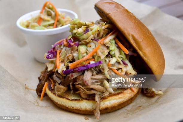 A pulled pork sandwich with a side of cole slaw is photographed at District BBQ July 03 2017 in Vienna VA