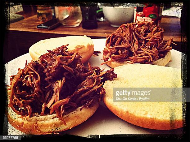 Pulled Pork Sandwiches On Table