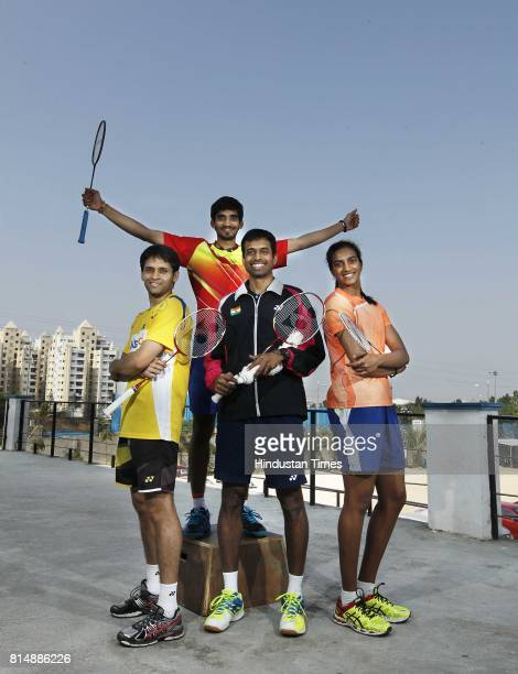 Pullela Gopichand former Indian badminton player with badminton players Parupalli Kashyap Srikanth Kidambi and P V Sindhu during an exclusive...
