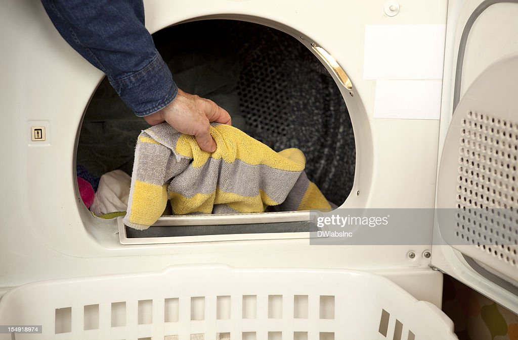 Pulling clothes out of the dryer