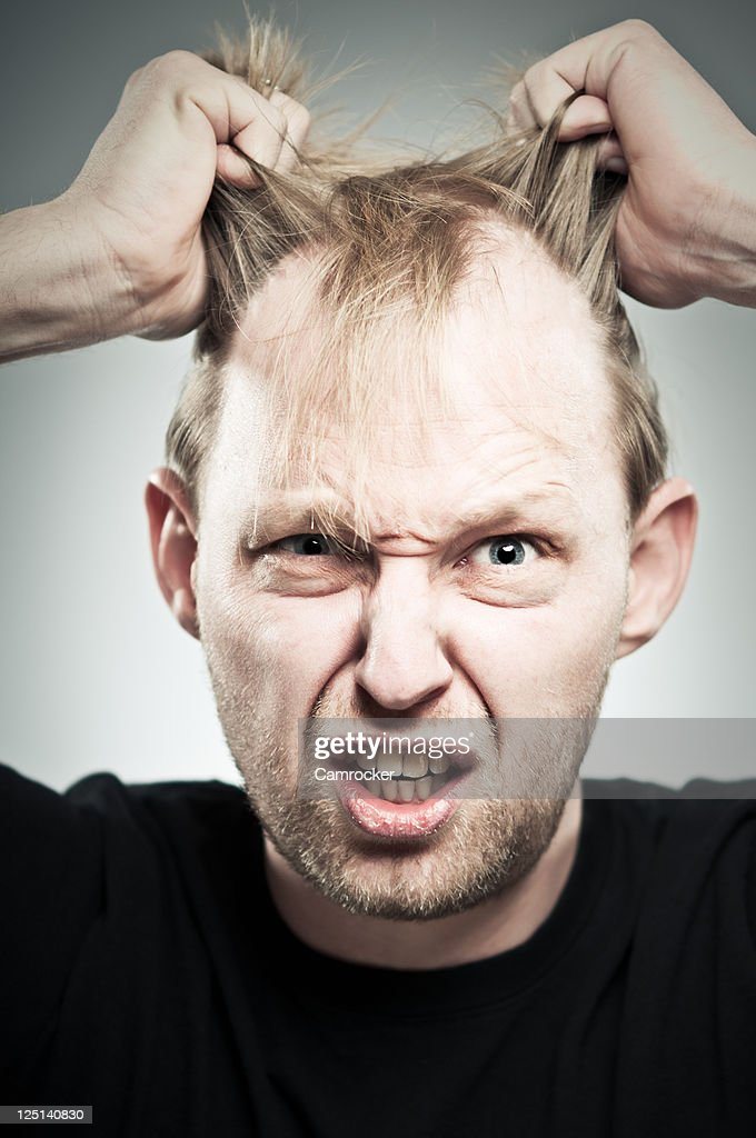 Pulling My Hair Out : Stock Photo