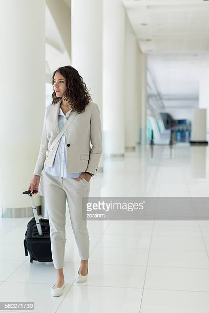 Pulling suitcase in airport