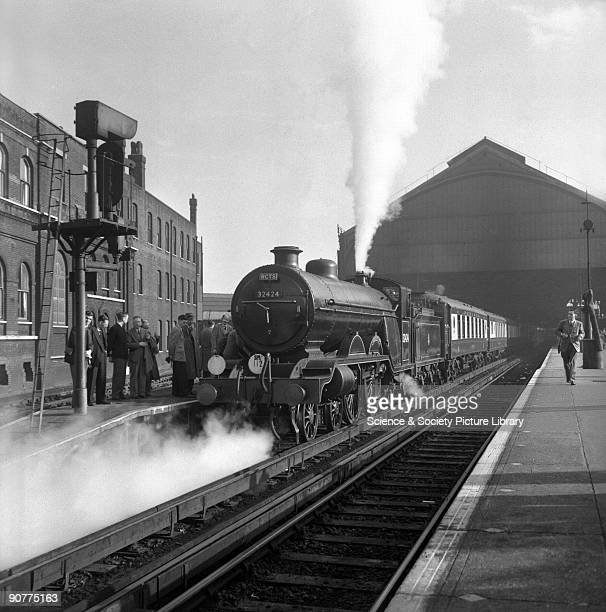 Pullman train hauled by a H2 class 442 locomotive number 32424 at Brighton station West Sussex by E D Bruton 5 October 1952 This station was the...