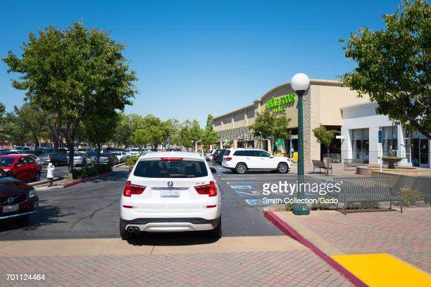 SUV pulls up to the Whole Foods Market grocery store in San Ramon California June 21 2017 In June of 2017 Amazoncom announced that it would acquire...