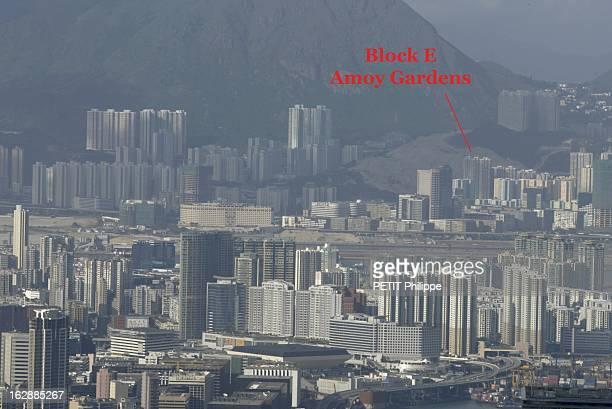 Hong Kong City Of Fear HONG KONG principal foyer du Syndrome respiratoire aigu sévère photomontage vue de la ville dans une légère avec une flèche...