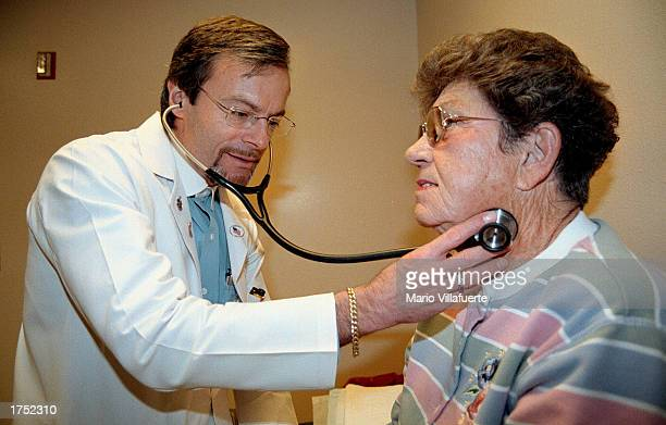 Pulmonologist Dr Loyd Whitley examines patient Robbie Roach during an office visit January 29 2003 in Bossier City Louisiana A portion of Roach's...