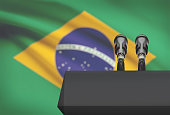 Pulpit and two microphones with a flag on background - Brazil