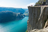 Many people on Preikestolen , Pulpit Rock 608m above Lysefjorden in Norway.