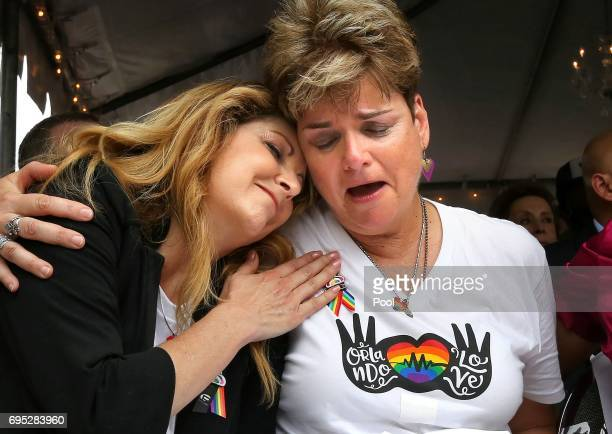 Pulse nightclub owner Barbara Poma comforts Orlando City commissioner Patty Sheehan attend the oneyear anniversary memorial service for victims of...