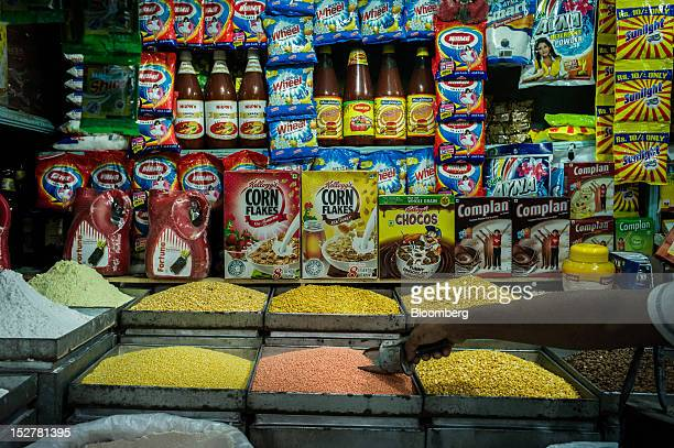 Pulses are displayed for sale in front of packaged goods at a local grocery store in the Kalahati market area in Siliguri West Bengal India on...