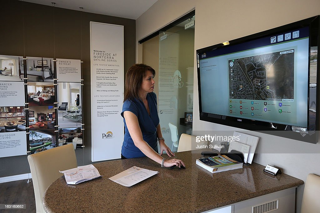 Pulte Homes sales associate Jennifer Grantham navigates a map of the Pulte Homes Fireside at Norterra-Skyline housing development on March 5, 2013 in Phoenix, Arizona. In 2008, Phoenix, Arizona was at the forefront of the U.S. housing crisis with home prices falling 55 percent between 2005 and 2011 leaving many developers to abandon development projects. Phoenix is now undergoing a housing boom as sale prices have surged 22.9 percent, the highest price increase in the nation, and homebuilders are scrambling to buy up land.