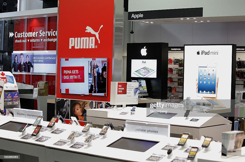 Puma and Apple Inc. displays are seen at a Future Shop store in Vancouver, British Columbia, Canada, on Thursday, March 7, 2013. Future Shop, Canada's largest consumer electronics retailer, offers home and entertainment products, including televisions, computers, cameras, MP3 players, video games, computer add-ons, software, and audo and video systems. Photographer: Deddeda White/Bloomberg via Getty Images