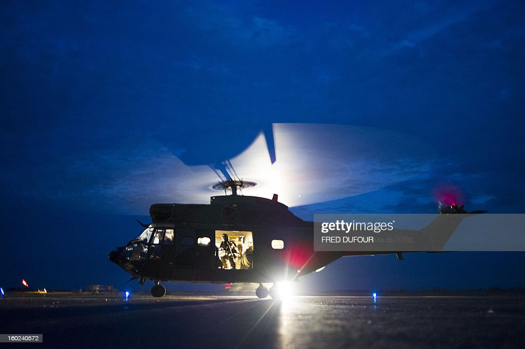 A Puma helicopter from the French Army with French soldiers flying back from the city of Timbuktu, arrive at the French army base camp on January 28, 2013 in Sevare, located 630 kilometers north-east of Bamako. French-led forces Monday seized Mali's fabled desert city of Timbuktu in a lightning advance north as fleeing Islamists torched a building housing priceless ancient manuscripts. AFP PHOTO / FRED DUFOUR