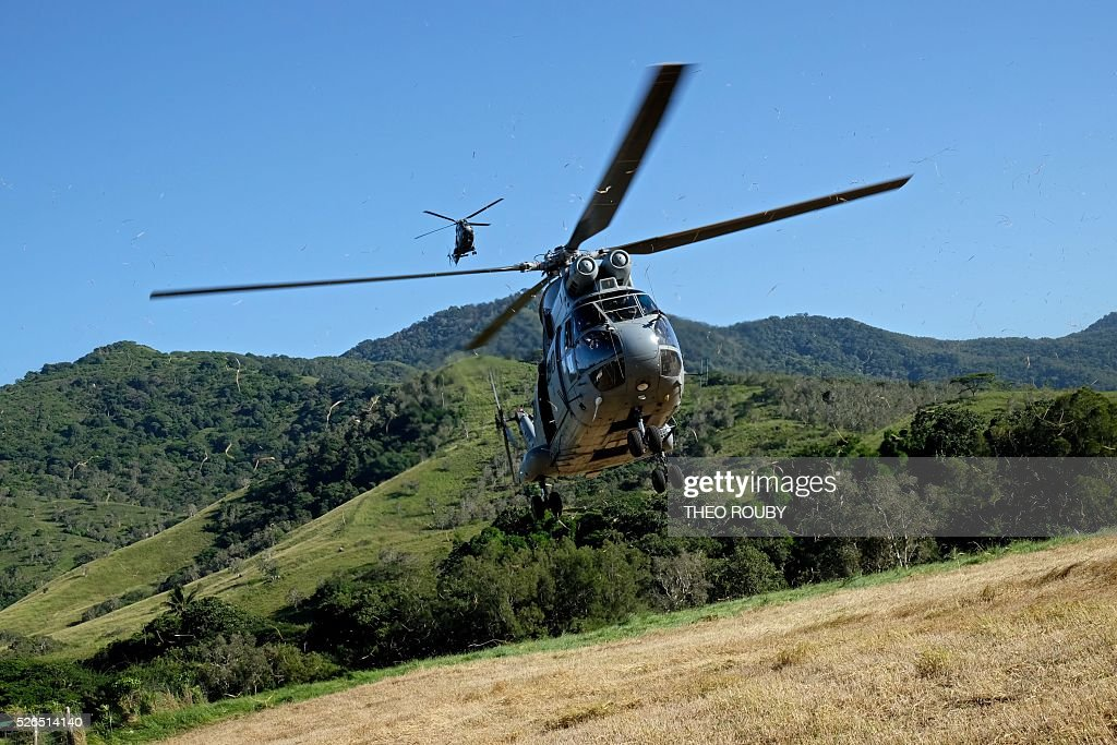 A Puma helicopter transporting the French prime minister lands in a farm on April 30, 2016 in La Foa, during visit to the French Pacific territory of New Caledonia. / AFP / Th��o Rouby