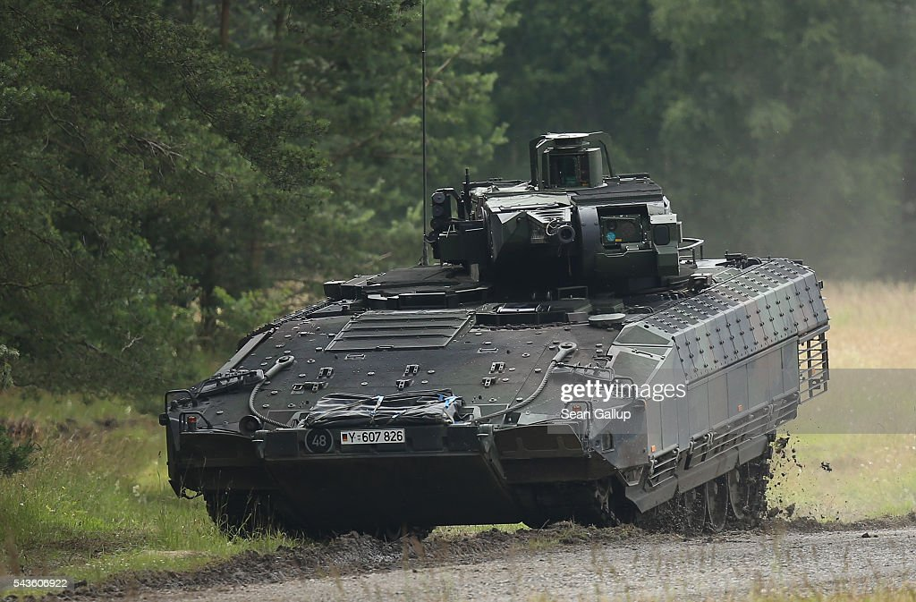 Puma infantry fighting vehicle of the Bundeswehr, the German armed forces, participates in a demonstration of capablities of Panzergranadierbataillon 33 of the 1st Panzer Division (1. Panzerdivision) on June 29, 2016 near Neustadt am Ruebenberge, Germany. The Bundeswehr is aquirung the Puma in phases and the vehicle replaces the Marder.