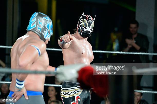 Puma King and Magnus perform onstage during the EXOTICOS VS LUCHADORES Lucha Libre Show hosted by La Fondation Cartier in Paris on November 3 2014 in...