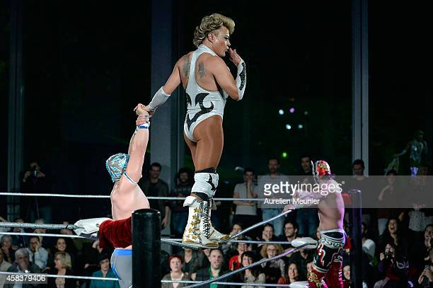 Puma King Cassandro El Exotico and Magnus perform onstage during the EXOTICOS VS LUCHADORES Lucha Libre Show hosted by La Fondation Cartier in Paris...