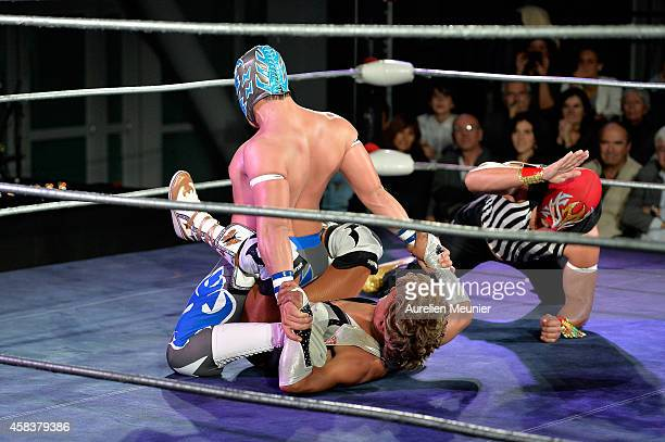 Puma King Cassandro El Exotico and Niebla Roja perform onstage during the EXOTICOS VS LUCHADORES Lucha Libre Show hosted by La Fondation Cartier in...