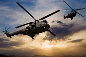 U.K. Airforce  Puma Military helicopters flying over  Kabul City at sunset, Afghanistan.
