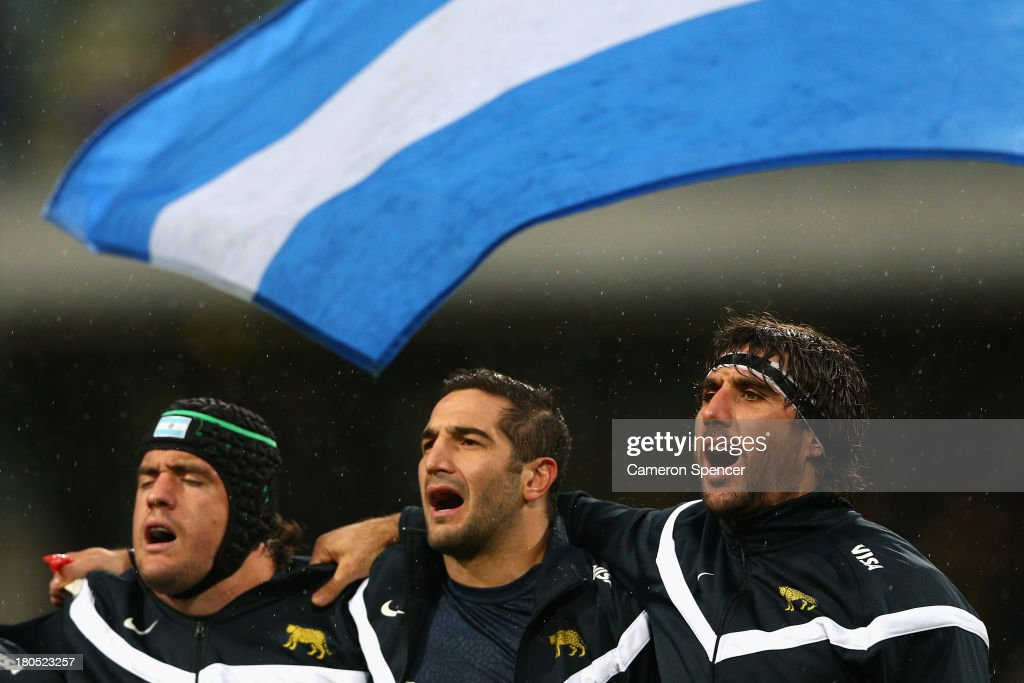 Pumas captain Juan Martín Fernández Lobbe (R) and team mates sing the Argentinian national anthem during The Rugby Championship match between the Australian Wallabies and Argentina at Patersons Stadium on September 14, 2013 in Perth, Australia.