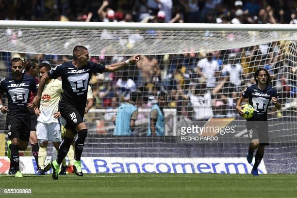 Pumas' forward Nicolas Castillo celebrates his goal agaist America during their Mexican Clausura tournament football match at the Olympic Stadium in...
