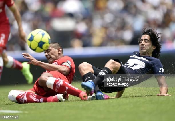 Pumas´ Matias Britos vies for the ball with Toluca´s Paulo da Silva during their Mexican Clausura 2017 Tournament football match at Olimpyc stadium...