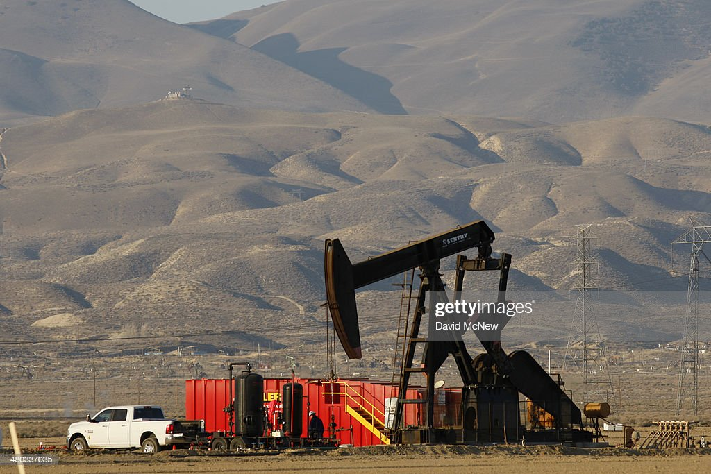 A pump jack and frac tanks stand in field being developed for drilling next to a farm over the Monterey Shale formation where gas and oil extraction using hydraulic fracturing, or fracking, is on the verge of a boom on March 24, 2014 near Lost Hills, California. Critics of fracking in California cite concerns over water usage and possible chemical pollution of ground water sources as California farmers are forced to leave unprecedented expanses of fields fallow in one of the worst droughts in California history. Concerns also include the possibility of earthquakes triggered by the fracking process which injects water, sand and various chemicals under high pressure into the ground to break the rock to release oil and gas for extraction though a well. The 800-mile-long San Andreas Fault runs north and south on the western side of the Monterey Formation in the Central Valley and is thought to be the most dangerous fault in the nation. Proponents of the fracking boom saying that the expansion of petroleum extraction is good for the economy and security by developing more domestic energy sources and increasing gas and oil exports.
