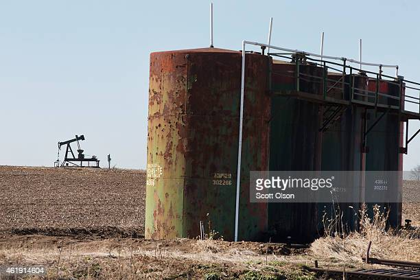 A pump jack used to extract crude oil from the ground and a tank battery used to temporarily store the freshlypumped crude sit above a well in a...
