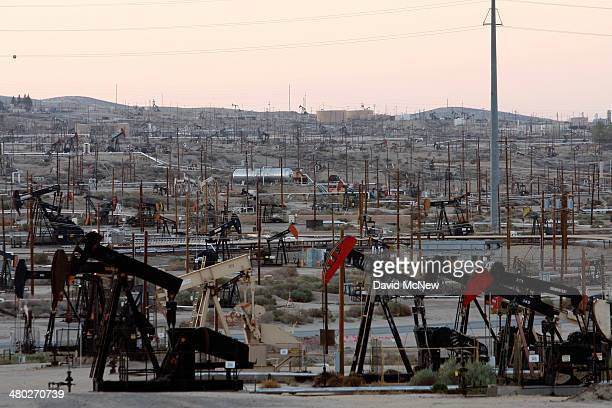 Pump jacks and wells are seen in an oil field on the Monterey Shale formation where gas and oil extraction using hydraulic fracturing or fracking is...