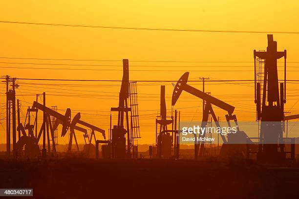 Pump jacks are seen at dawn in an oil field over the Monterey Shale formation where gas and oil extraction using hydraulic fracturing or fracking is...