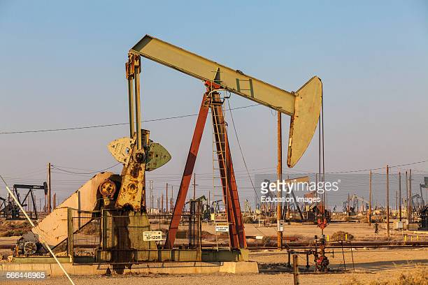 Pump jacks at the Lost Hills Oil Field and hydraulic fracking site Kern County San Joaquin Valley California