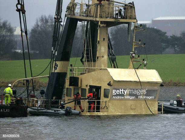 Pumping equipment is taken on board The Flying Phantom tug as the barge GPS Atlas continues its salvage operation on the river Clyde The Flying...