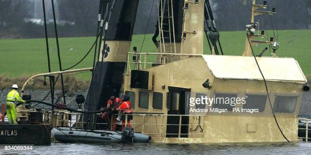Pumping equipment is taken on board The Flying Phantom tug as the barge GPS Atlas continues its salvage operation on the river ClydeThe Flying...