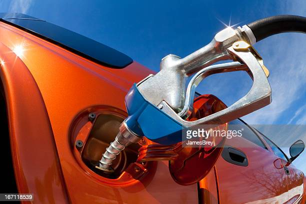 Pumping Fuel Into Gas-Guzzler Vehicle