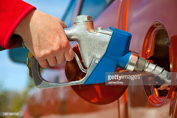Pumping Gas Into Gas-Guzzler Vehicle