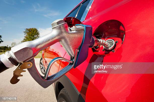 Pumping Gas Into Red Vehicle