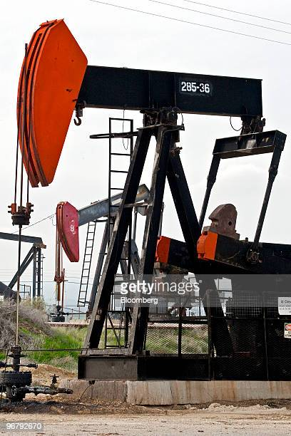 A pumpjack also known as a nodding donkey operates above a Chevron Corp oil well in the MidwaySunset oil field near Taft California US on Thursday...