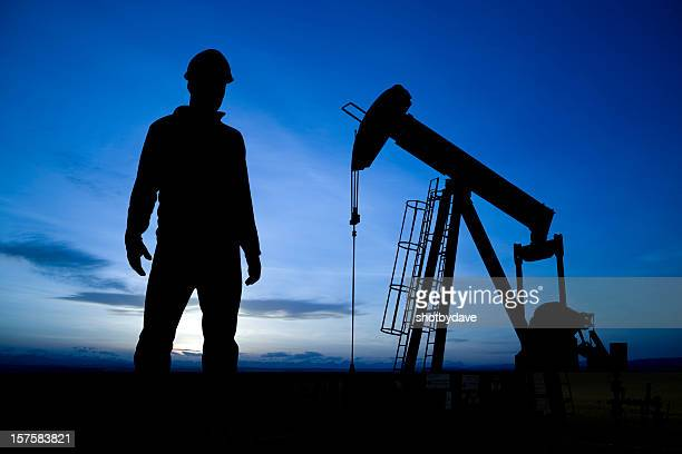 Pumpjack and Worker at dusk