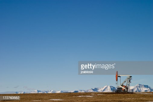 pumpjack by the mountains