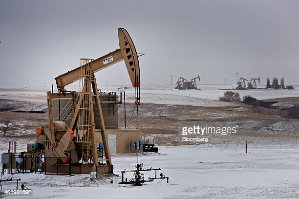 A pumpjack operates at an oil well in Williston North Dakota US on Sunday Feb 15 2015 A plunge in global energy prices that has put some North Dakota...